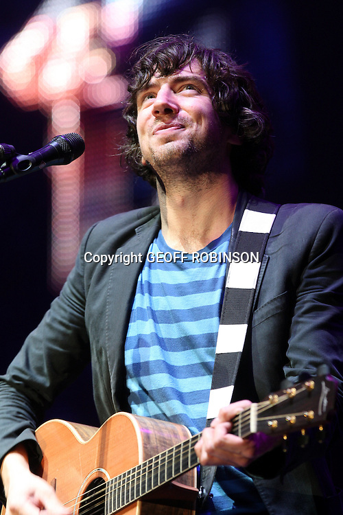 PIC SHOWS    GARY LIGHTBODY OF SNOW PATROL ON SUNDAY AT THE V FESTIVAL AT HYLANDS PARK,CHELMSFORD,ESSEX...Oasis, The Killers, Lily Allen, Katy Perry and Lady Gaga are among the acts performing at Virgin Media's V Festival this weekend...Thousands of festival-goers have  descended upon Hylands Park in Chelmsford and Staffordshire's Weston Park to set up camp ready for two days of live music and partying...Oasis are set to headline the V Stage in Staffordshire on Saturday night and close the festival in Chelmsford on Sunday night, although Gallagher brothers Noel and Liam recently revealed they are not speaking to each other...Peter Doherty - renowned for his battle with drug addiction - is due to play a solo acoustic set at the Virgin Media stage in Chelmsford on Saturday night, while soon to be Strictly Come Dancing judge Alesha Dixon is performing on the 4Music stage on Sunday.
