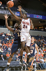 Virginia Cavaliers G/F Mamadi Diane (24) elevates for a finger roll around Carson-Newman F Bobby Guyton (1).  The Virginia Cavaliers men's basketball team defeated the Carson-Newman Eagles 124-65 in an exhibition basketball game at the John Paul Jones Arena in Charlottesville, VA on November 4, 2007.