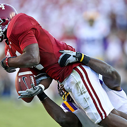 November 6, 2010; Baton Rouge, LA, USA;  LSU Tigers cornerback Patrick Peterson (7) breaks up a pass intended for Alabama Crimson Tide wide receiver Marquis Maze (4) during the second half at Tiger Stadium. LSU defeated Alabama 24-21.  Mandatory Credit: Derick E. Hingle