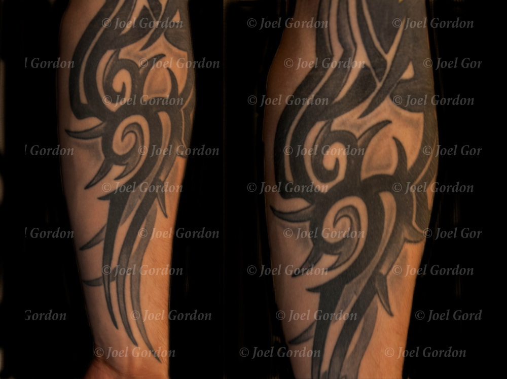 Close up of Manuel's  tribal tattoo on his arm.  Artist - Dan, Fat Kat's tattoo Shop<br />