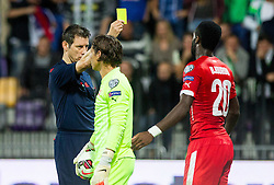 Referee Wolfgang Stark (GER) with yellow card for Johan Djourou of Switzerland during football match between National teams of Slovenia and Switzerland at Round 2 of Euro 2016 Qualifications, on October 9, 2014 in Stadium Ljudski vrt, Maribor, Slovenia. Photo by Vid Ponikvar / Sportida.com