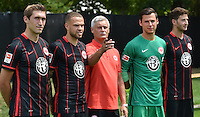 German Soccer Bundesliga 2015/16 - Photocall Eintracht Frankfurt on 15 July 2015 in Frankfurt, Germany: coach Armin Veh (M) presents the new signings Stefan Reinartz (l-r), Luc Castaignos, Heinz Lindner and David Abraham.
