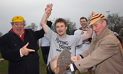 "© Licensed to London News Pictures. 03/03/2012. London, England. L-R Terry Jones, Ben Lansley, winner of the 400m race and Michael Palin. Terry Jones and Michael Palin of Monty Pythons fame today, Saturday 3 March, staged a public ""Hopathon"" to mark the DVD release of Ripping Yarns The Complete Series, and as an homage to the episode entitled Tomkinson's School Days at the Athletics Track in  Hampstead Heath, London. Photo credit: Bettina Strenske/LNP"