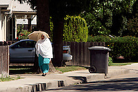 LODI, CA - JUNE 10:  A Muslim woman walks down the street on June 10, 2005 in Lodi California. Lodi, the sleepy Northern California town has been hit with controversy after 5 people were arrested by the FBI in connection with immigration and possible terrorist activities.   Photograph by David Paul Morris