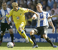 Photo: Aidan Ellis.<br /> Sheffield Wednesday v Leeds United. Coca Cola Championship. 27/08/2006.<br /> Leeds Eddie Lewis (L) skips away from Wednesday's Glenn Whelan