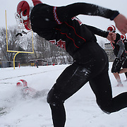 Michael Cognetta, New Canaan, celebrates victory by sliding in the snow with team mates during the New Canaan Rams Vs Darien Blue Wave, CIAC Football Championship Class L Final at Boyle Stadium, Stamford. The New Canaan Rams won the match in snowy conditions 44-12. Stamford,  Connecticut, USA. 14th December 2013. Photo Tim Clayton