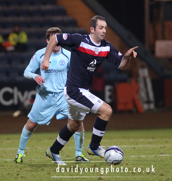 Gary Harkins goes past Patrick Cregg  - Dundee v St Johnstone - Clydesdale Bank Scottish Premier League at Dens Park .. - © David Young - www.davidyoungphoto.co.uk - email: davidyoungphoto@gmail.com