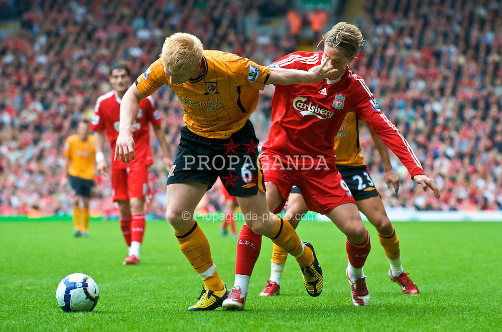 LIVERPOOL, ENGLAND - Saturday, September 26, 2009: Liverpool's Fernando Torres gets a hand in his face from Hull City's Paul McShane during the Premiership match at Anfield. (Photo by: David Rawcliffe/Propaganda)