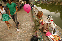 For a Frugal Paris story by Matt Gross..The Pink Flamingo is a pizza delivery place, near Canal St. Martin, Paris 10, and it delivers to the Canal, having given the person a pink baloon, so that the bicyscle deliverer can find the person on the canal...photograph by Owen Franken for the NY Times..June 13, 2009..