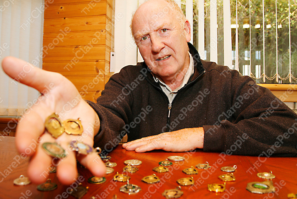 Gus Lohan with some of his many GAA medals which include 11 County and 1 Munster medals with Newmarketonfergus.<br />