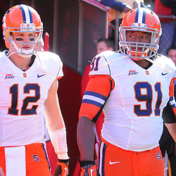 Oct 13, 2012: Syracuse Orange quarterback Ryan Nassib (12) and defensive end Brandon Sharpe (91) take the field as captains for NCAA Big East college football action between the Rutgers Scarlet Knights and Syracuse Orange at High Point Solutions Stadium in Piscataway, N.J.
