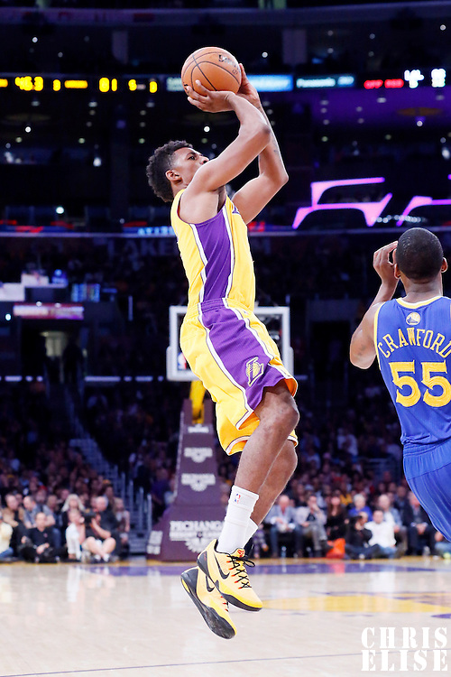 11 April 2014: Los Angeles Lakers forward Nick Young (0) takes a jump shot over Golden State Warriors guard Jordan Crawford (55) during the Golden State Warriors 112-95 victory over the Los Angeles Lakers at the Staples Center, Los Angeles, California, USA.