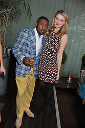 TOLU ADEKO founder of The Hub magazine and AMBER ATHERTON at a tea party organised by The Hub Magazine in aid of charity Kids Company held at The Sanderson, Berners Street, London on 2nd May 2012.
