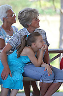 Verlee Hiner (top) and her granddaughter, Grace Matus, 8, both of Springville, listen to a speaker at the flag disposal ceremony at the Springville Fire Department in Springville on Saturday, June 9, 2012. The flag disposal ceremony was organized by the Springville American Legion Post. (Stephen Mally/Freelance)