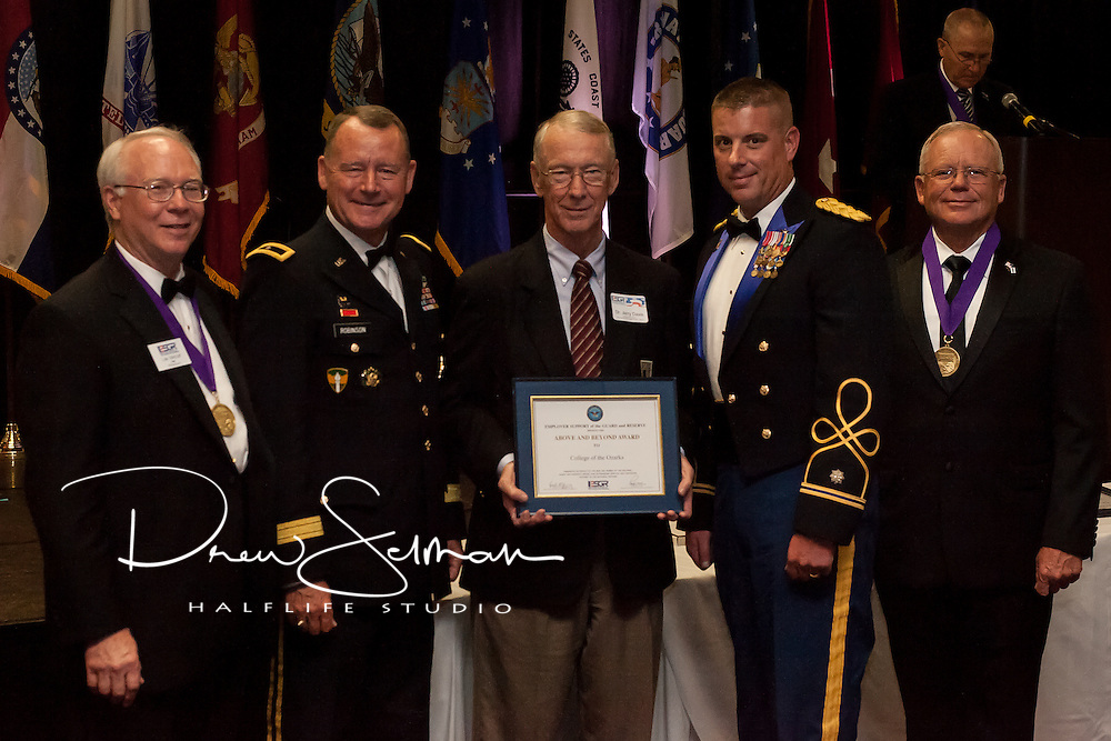 "Dr. Jerry Davis (c.) and Lt. Col. James Schreffler (c.r.) receive the ""Above and Beyond Award"" on behalf of College of the Ozarks from Rear. Adm. (Ret.) Lee Metcalf (l.), MO ESGR State Chair, Brig. Gen. Martin Robinson (c.l.), Assistant Adjutant General Support for Missouri National Guard and Maj. Gen. (Ret.) Paul E. Mock (r.), National Chair for ESGR at the MO ESGR 2014 Annual Awards Dinner in Jefferson City on August 8, 2014.  ESGR, a DOD office, works employers to support and value the employment of National Guard and Reserve military. (MO ESGR / Drew Selman)"