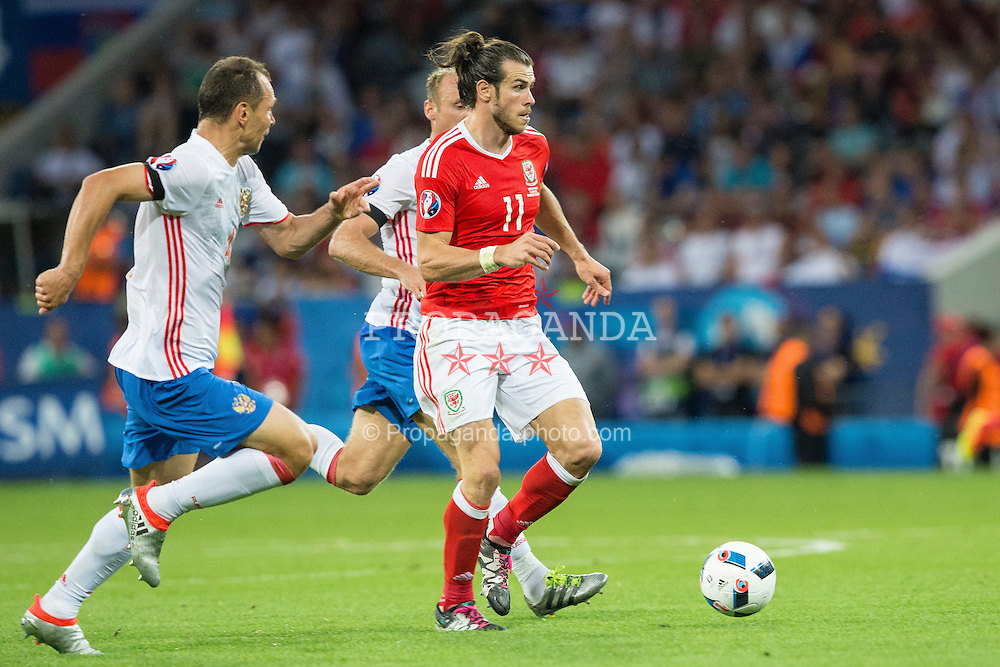 TOULOUSE, FRANCE - Monday, June 20, 2016: Wales' Gareth Bale in action against Russia during the final Group B UEFA Euro 2016 Championship match at Stadium de Toulouse. (Pic by Paul Greenwood/Propaganda)