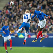 PARIS, FRANCE - March 25:  Paul Pogba #6 of France wins a header while challenged by Hordur Bjorgvin Magnusson #18 of Iceland during the France V Iceland, 2020 European Championship Qualifying, Group Stage at  Stade de France on March 25th 2019 in Paris, France (Photo by Tim Clayton/Corbis via Getty Images)