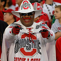 """Ohio State fan John """"Buck I Guy"""" Chubb, of Columbus, Ohio, cheers on his Buckeyes during their 26-17 victory over the Oregon Ducks in the 96th Rose Bowl, in Pasadena, Calif., on Jan. 1, 2010."""