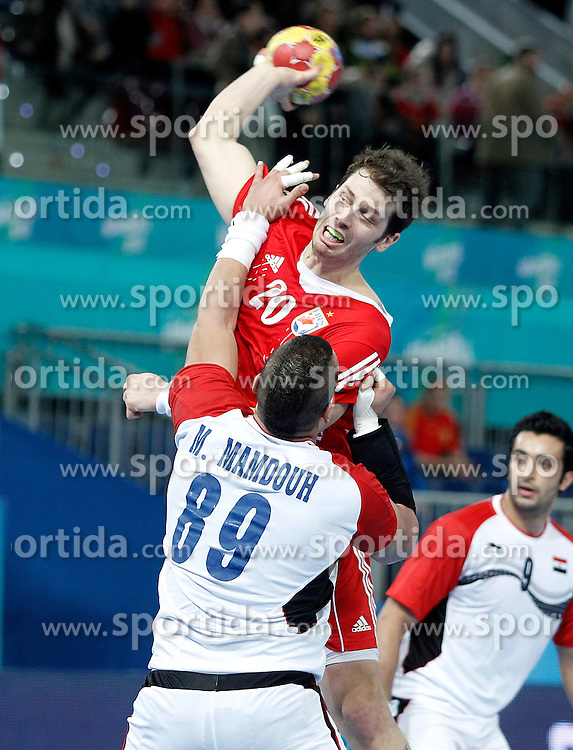17.01.2012, Caja Magica, Madrid, ESP, IHF, 23. Handball Weltmeisterschft der Herren, 1. Runde, Kroatien vs Aegypten, im Bild Croatia's Damir Bicanic (t) and Egypt's Mohamed Mamdouh // during the preliminary round match of 23th IHF Handball World Championship between Croatia and Egypt at the Caja Magica, Madrid, Spain on 2013/01/17. EXPA Pictures © 2013, PhotoCredit: EXPA/ Alterphotos/ Acero..***** ATTENTION - OUT OF ESP and SUI *****