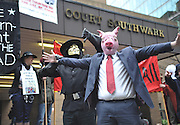 Picture by Mark Larner/Central News. Picture shows people protesting against the MPs expenses scandal outside Southwark Crown Court. 30th March 2010. Today saw the preliminary hearing in to David Chaytor, Elliot Morley and Jim Devine, all of whom face charges of false accounting relating to their expenses claims.