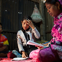 Jahanara spends every morning at home tutoring Junaki (her niece age 9) and Mishu (her nephew age 8).<br />