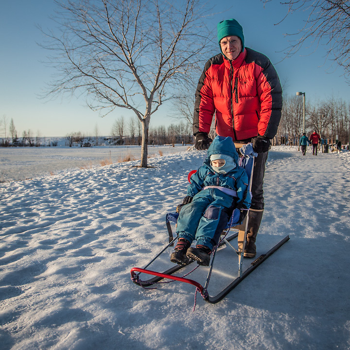 """""""We went out for a walk and Talvin fell asleep.""""  """"Anchorage is a real jack-pot for a guy like me…lot's to do out of doors.""""  -David Wigglesworth with his seven year old son at Westchester Lagoon, Anchorage"""
