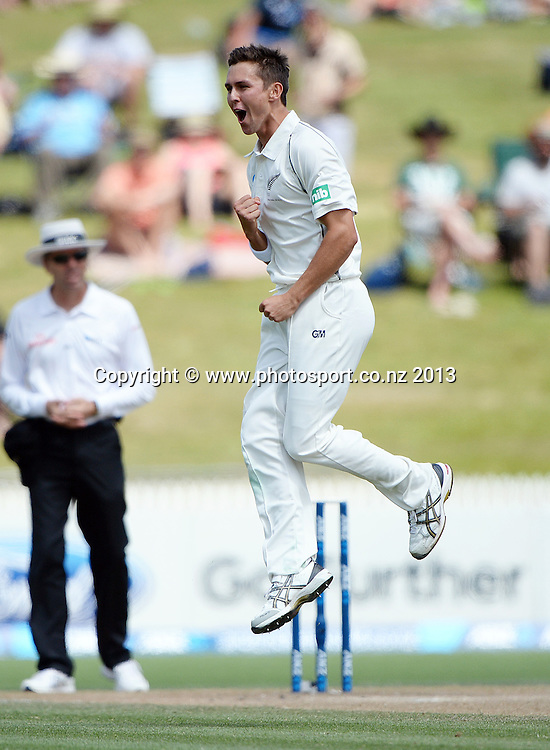 Trent Boult celebrates the wicket of Kraigg Brathwaite on Day 3 of the 3rd cricket test match of the ANZ Test Series. New Zealand Black Caps v West Indies at Seddon Park in Hamilton. Saturday 21 December 2013. Photo: Andrew Cornaga / www.Photosport.co.nz