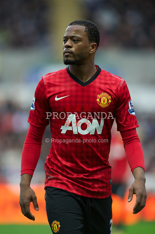 SWANSEA, WALES - Sunday, December 23, 2012: Manchester United's Patrice Evra in action against Swansea City during the Premiership match at the Liberty Stadium. (Pic by David Rawcliffe/Propaganda)
