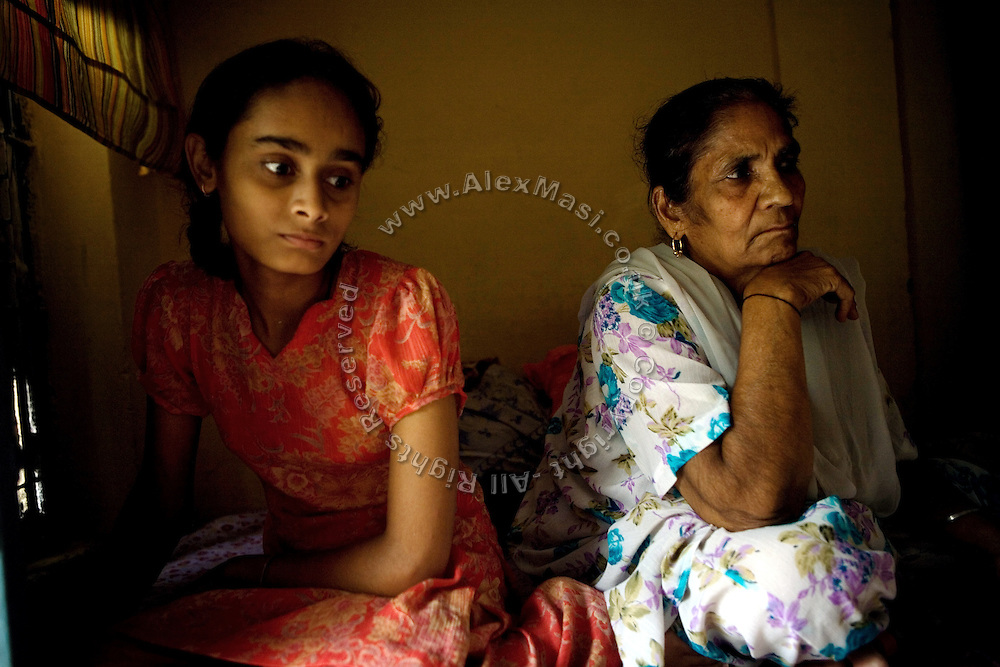 Surinder Kaur, 65, (right) is portrayed in another widow's home in Tilak Vihar, New Delhi, India. She has lost her husband and other members of her family during the anti-Sikh riots erupted in New Delhi in 1984 in the light of Indira Gandhi's assassination by her Sikh bodyguards.