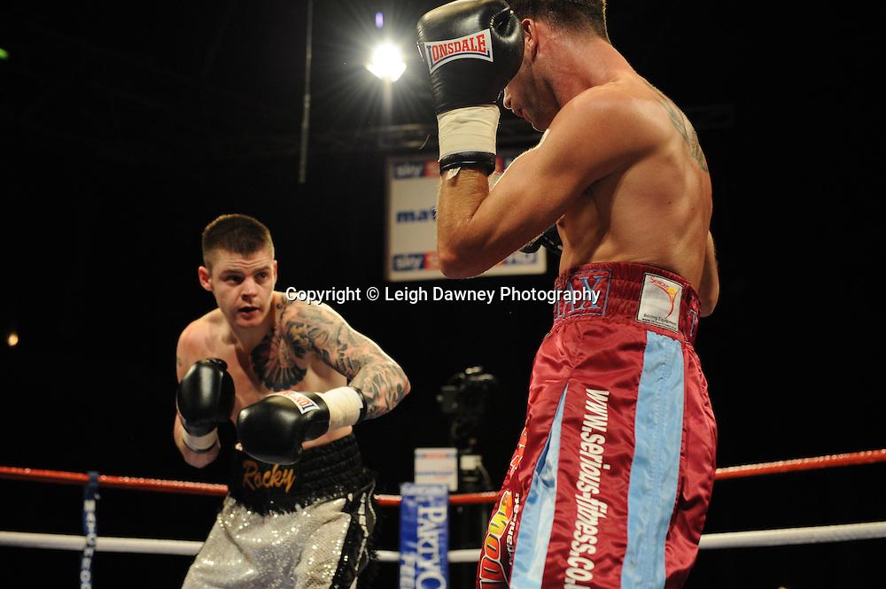 Michael Lomax defeats Dave Ryan (grey shorts) on the 9th April 2010 at Alexandra Palace, London. Matchroom Sport. Photo credit: © Leigh Dawney