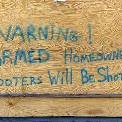 A home owner warns what he will do to looters on Hesiod St. in the city of Metairie a suburb of New Orleans during the aftermath of Hurricane Katrina that has destroyed New Orleans, Louisiana and parts of Mississippi Wednesday, September 7, 2005 in New Orleans,Louisiana. <br /> (Pasadena Star-News Keith Birmingham)