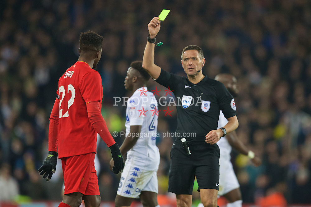 LIVERPOOL, ENGLAND - Tuesday, November 29, 2016: Liverpool's Divock Origi is shown a yellow card by referee Andre Marriner during the Football League Cup Quarter-Final match at Anfield. (Pic by David Rawcliffe/Propaganda)