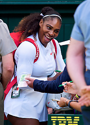 LONDON, ENGLAND - Tuesday, July 10, 2018: Serena Williams (USA) signs autographs for fans after her 3-6, 6-3, 6-4 victory during the Ladies' Singles Quarter-Final match on day eight of the Wimbledon Lawn Tennis Championships at the All England Lawn Tennis and Croquet Club. (Pic by Kirsten Holst/Propaganda)