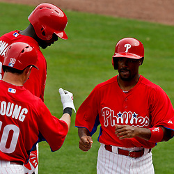 Feb 26, 2013; Clearwater, FL, USA; Philadelphia Phillies shortstop Jimmy Rollins (11) celebrates with first baseman Ryan Howard (6) and third baseman Michael Young (10) after scoring on a double by second baseman Kevin Frandsen (not pictured) during the bottom of the sixth inning of a spring training game at Bright House Field. Mandatory Credit: Derick E. Hingle-USA TODAY Sports