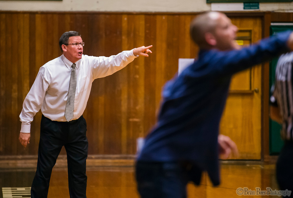 Placer Hillman head coach Mark Lee and Liberty Ranch Hawks head coach Josh Williams call plays to their teams as the Placer Hillman host the Liberty Ranch Hawks Varsity basketball team in the DIV NorCal boys quarterfinal, Saturday Mar 10, 2018.  <br /> photo by Brian Baer