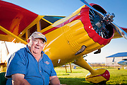 """Portrait of Tom Dinndorf, who fully restored this Stinson Reliant SR 10 """"Gull Wing"""".  It was originally purchased by Shell Oil in 1938, and flown by Jimmy Doolittle for two years before WWII.  AirVenture 2010, Oshkosh, Wisconsin."""