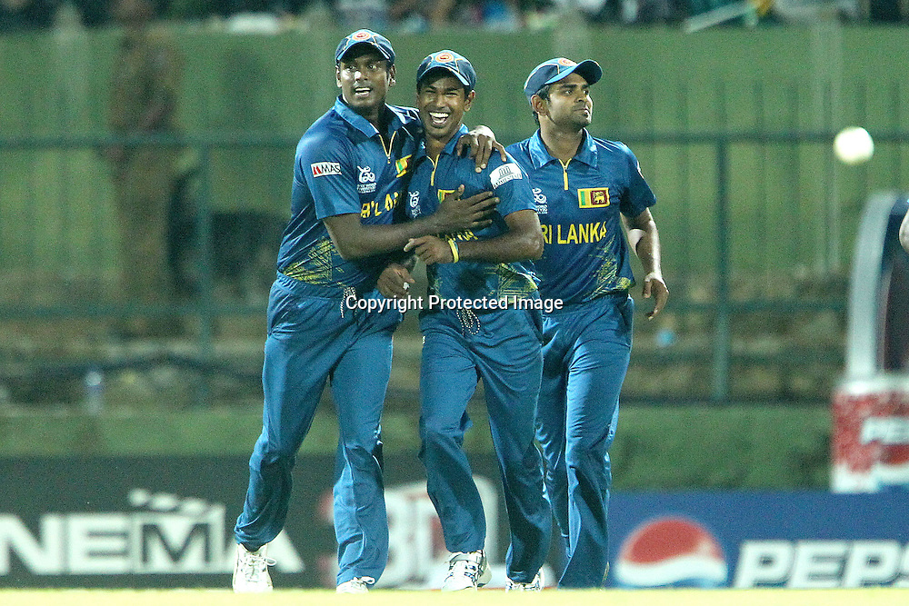 Nuwan Kulasekara celebrates catching the wicket of Jonny Bairstow of England  during the ICC World Twenty20 Super Eights match between England and Sri Lanka held at the  Pallekele Stadium in Kandy, Sri Lanka on the 1st October 2012<br /> <br /> Photo by Ron Gaunt/SPORTZPICS