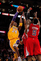 25 February 2011: Guard Kobe Bryant of the Los Angeles Lakers passes the ball while being guarded by Randy Foye of the Los Angeles Clippers during the second half of the Lakers 108-95 victory over the Clippers at the STAPLES Center in Los Angeles, CA.