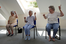 Older women taking part in a keep fit class,
