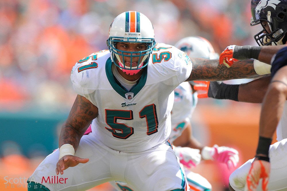 Miami Dolphins center Mike Pouncey (51) during the Dolphins 18-15 overtime loss to the Denver Broncos at Sun Life Stadium on Oct. 22, 2011 in Miami Gardens, Fla.  ..©2011 Scott A. Miller