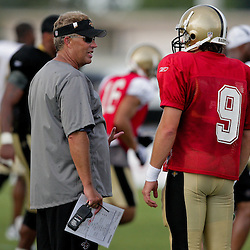 04 August 2009: Saints defensive coordinator Gregg Williams talks with quarterback Drew Brees (9) during New Orleans Saints training camp at the team's practice facility in Metairie, Louisiana.