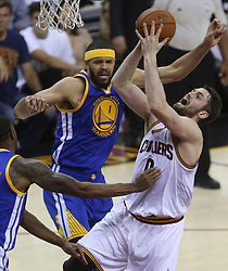 The Cleveland Cavaliers' Kevin Love, right, puts up a shot as the Golden State Warriors' JaVale McGee defends in the first half during Game 4 of the NBA Finals at Quicken Loans Arena in Cleveland on Friday, June 9, 2017. (Photo by Phil Masturzo/Akron Beacon Journal/TNS) *** Please Use Credit from Credit Field ***