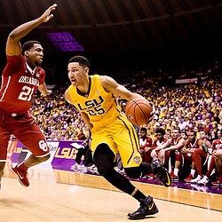 Jan 30, 2016; Baton Rouge, LA, USA; LSU Tigers forward Ben Simmons (25) drives past Oklahoma Sooners forward Dante Buford (21) during the first half of a game at the Pete Maravich Assembly Center. Mandatory Credit: Derick E. Hingle-USA TODAY Sports