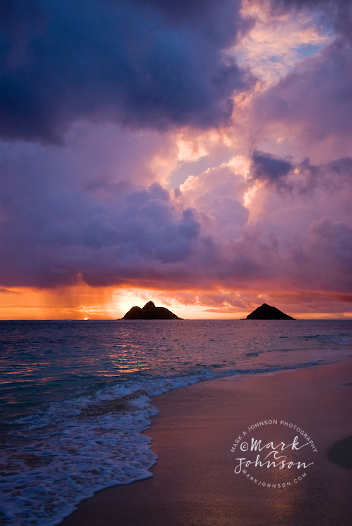 Sunrise at Lanikai Beach, Mokulua Islands offshore, Oahu, Hawaii