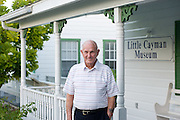 LInton Tibbetts of Cayman Brac stands at the museum he built in Little Cayman, photo by Courtney Platt