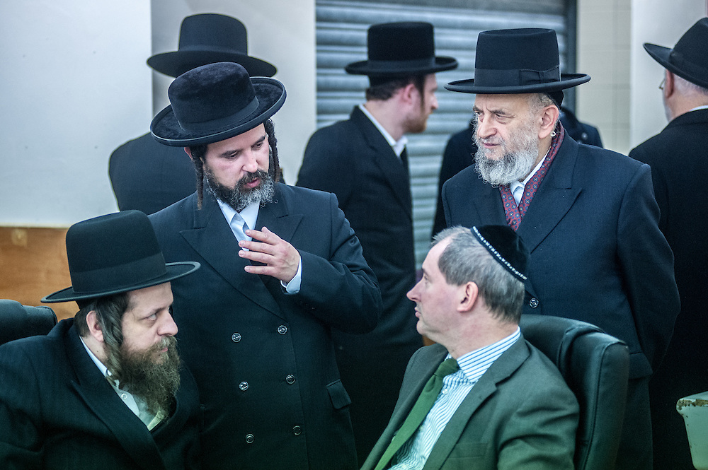 London, UK - 3 December 2014: members of the community talk to Mr Stephen Williams MP, Parliamentary Under Secretary of State for Communities and Local Government, as he visits Talmud-Torah Yetev-Lev orthodox Jewish school in Hackney, London