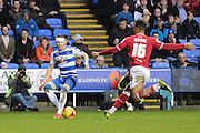 Bristol City defender Liam Moore attempts to block Reading defender Chris Gunter during the Sky Bet Championship match between Reading and Bristol City at the Madejski Stadium, Reading, England on 2 January 2016. Photo by Jemma Phillips.