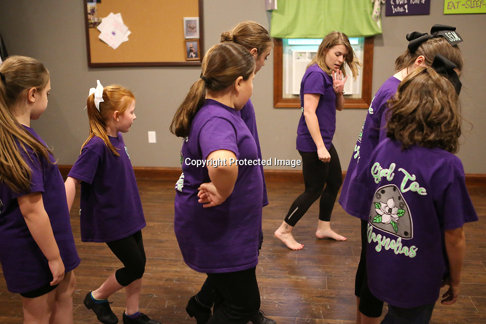 Leah Doyle, center right, instructor of the Steel Toe Magnolias clogging group, teaches the girls a new move called the clogging square in the studio at her home in Amory. Doyle teaches a competitive group ages 7-18, a youth class ages 2-6 and an adult class each week.