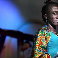 Nederland, Amsterdam , 12 oktober 2014.<br /> Amoiloeloe Doekoe Alias Joney (l) uit Pikin Slee, een dorp uit de binnenlanden van Suriname in de kerk bij Ruigoord waar het culturele evenement Magie, muziek en Poezie uit Suriname plaats vindt.<br /> Foto:Jean-Pierre Jans