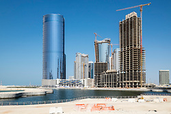 Modern high-rise residential and office buildings under construction at future City of Lights on Al Reem Island in Abu Dhabi United Arab Emirates